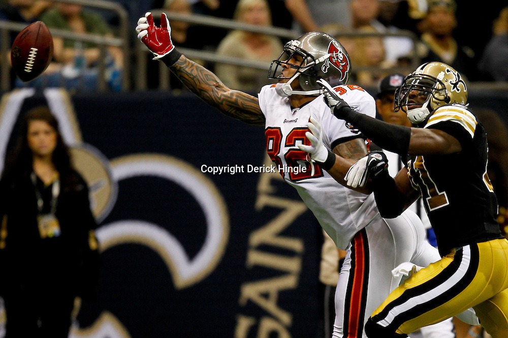 November 6, 2011; New Orleans, LA, USA; Tampa Bay Buccaneers tight end Kellen Winslow (82) reaches for the ball as New Orleans Saints safety Roman Harper (41) defends during the fourth quarter of a game at the Mercedes-Benz Superdome. The Saints defeated the Buccaneers 27-16. Mandatory Credit: Derick E. Hingle-US PRESSWIRE