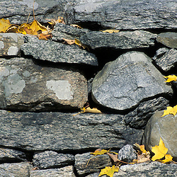 A stone wall in the front yard of the Main House on the Henderson property in Connecticut's Litchfield Hills.  New Milford, CT