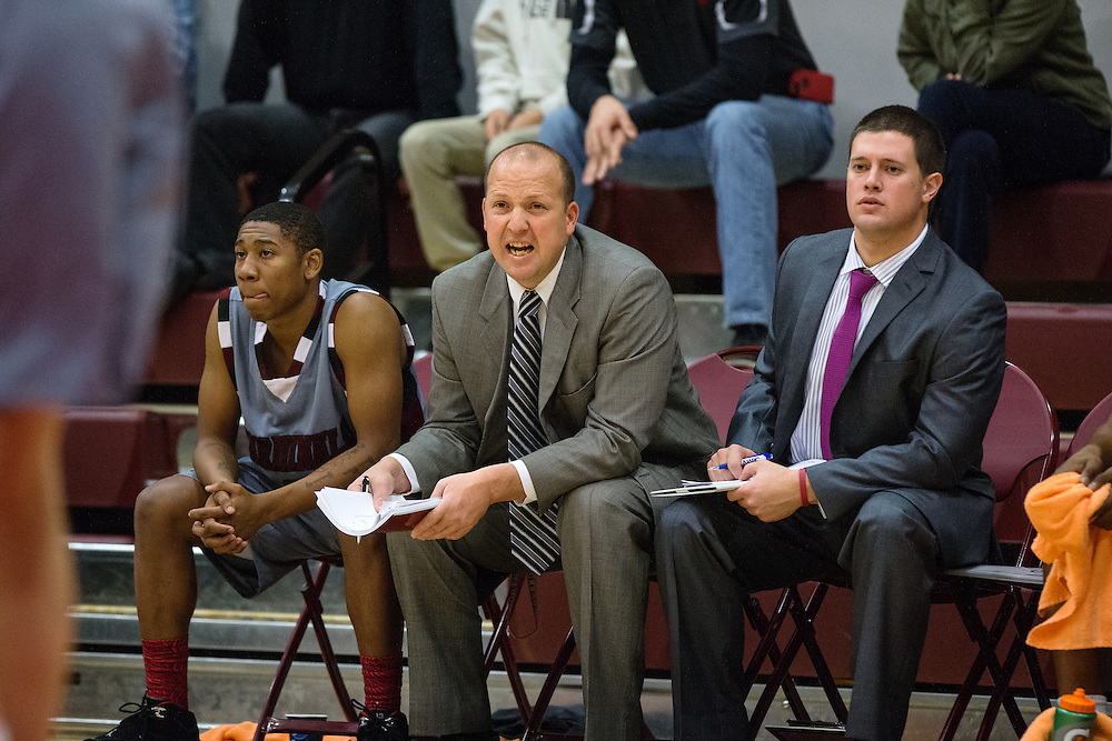 GABE GREEN/Press<br /> <br /> NIC assistant men&rsquo;s basketball coach Corey Symons, middle, shouts advice to players from the sidelines Saturday as NIC took on Arizona Western.