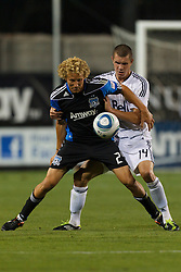 July 20, 2011; Santa Clara, CA, USA;  San Jose Earthquakes forward Steven Lenhart (24) is defended by Vancouver Whitecaps defender Greg Janicki (14) during the second half at Buck Shaw Stadium. San Jose tied Vancouver 2-2.