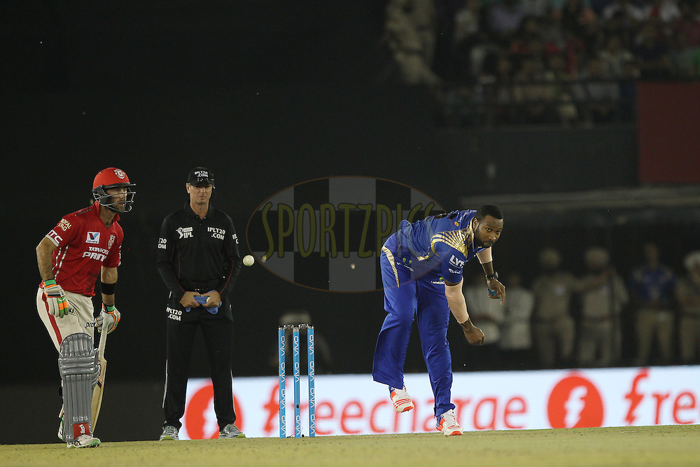 Kieron Pollard of Mumbai Indians lets the ball slip from his hand and it hits Umpire Rod Tucker during match 21 of the Vivo Indian Premier League ( IPL ) 2016 between the Kings XI Punjab and the Mumbai Indians held at the IS Bindra Stadium, Mohali, India on the 25th April 2016<br /> <br /> Photo by Ron Gaunt / IPL/ SPORTZPICS