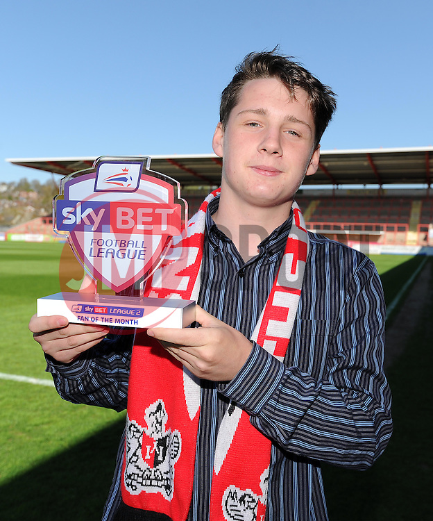 Sky Bet Football League Fan of the month, Joe McCrea, an Exeter City fan, poses with the trophy. - Photo mandatory by-line: Harry Trump/JMP - Mobile: 07966 386802 - 18/04/15 - SPORT - FOOTBALL - Sky Bet League Two - Exeter City v Southend United - St James Park, Exeter, England.