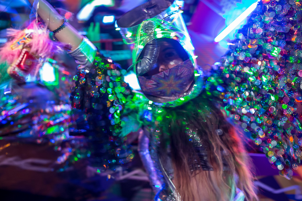 New York, NY - 31 October 2015. A woman bedecked in a glittery costume dancing at the start of the annual Greenwich Village Halloween Parade.