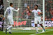 England's Raheem Sterling & Jamie Vardy celebrate England's 2nd goal  during the UEFA European 2016 Qualifier match between England and Estonia at Wembley Stadium, London, England on 9 October 2015. Photo by Shane Healey.