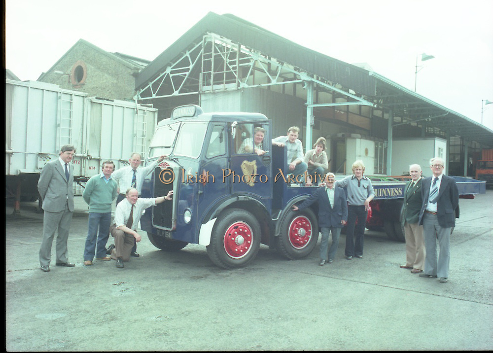 "Handover of Old Guinness Truck.   (M83)..1979..24.07.1979..07.24.1979..24th July 1979..The Albion Truck registration number RLV 154 was officially handed over to the Howth, National Transport Museum today. The vehicle was found in a scrap yard and purchased by the museum. History checking on the vehicle found that it had been part of the Guinness fleet both in Ireland and England. On hearing about the truck Guinness came on board and helped restore the vehicle to its former glory. An  eight wheeler of model type HD57 it is classed as a very rare model. The truck is powered by a six cylinder 'Whispering Giant' engine..Albion were a commercial vehicle builder based in Scotland..To see this and many other rare vehicles The museum is located in the Heritage Depot, Howth Demesne, Howth, Ireland. 60 vehicles are currently in Howth on display. .Image shows some of the staff who were engaged in the refurbishment of the ""Guinness Albion""."