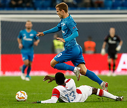 October 4, 2018 - Saint Petersburg, Russia - Aleksandr Kokorin (top) of FC Zenit Saint Petersburg and Michael Ngadeu-Ngadjui of SK Slavia Prague vie for the ball during the Group C match of the UEFA Europa League between FC Zenit Saint Petersburg and SK Sparta Prague at Saint Petersburg Stadium on October 4, 2018 in Saint Petersburg, Russia. (Credit Image: © Mike Kireev/NurPhoto/ZUMA Press)