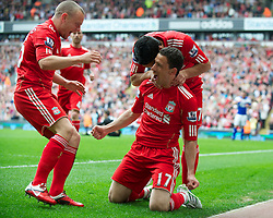 LIVERPOOL, ENGLAND - Saturday, April 23, 2011: Liverpool's Maximiliano Ruben Maxi Rodriguez celebrates scoring his side's first goal against Birmingham City, the first of his hat-trick of goals, during the Premiership match at Anfield. (Photo by David Rawcliffe/Propaganda)