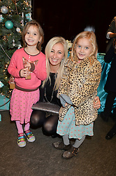 JENNY HALPERN-PRINCE and her daughters, left, SAM BELLE PRINCE and right CHARLIE PRINCE at the official opening of the 2014 Tiffany & Co.Christmas Shop on Bond Street, London on 16th November 2014.