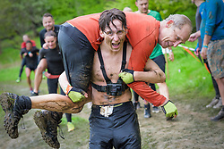 © Licensed to London News Pictures. 28/04/2018. Henley-on-Thames, UK. PRINCE TOMASZ LUBOMIRSKI of Poland and his son TOMMY, relatives of Royal wedding photographer Alexi Lubomirski, take part in the 10 miles Tough Mudder in Henley-on-Thames, April 28, 2018. The hard core obstacle course boasts over 2.5 million contestants since its creation in 2010.. Photo credit: Andre Camara/LNP
