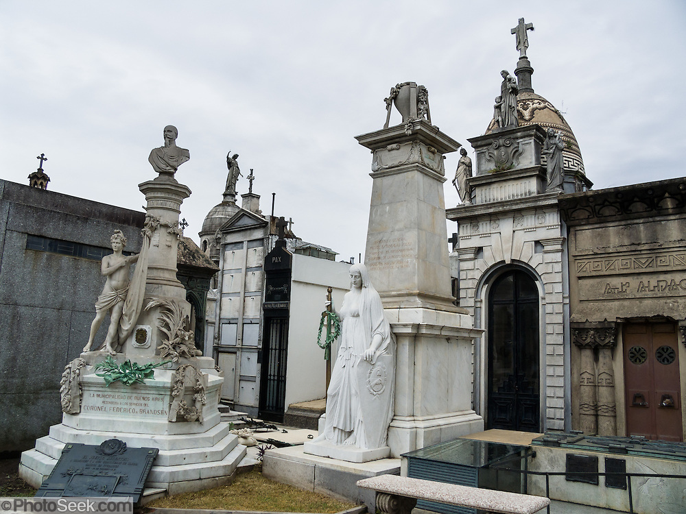 Tomb of Coronel Federico de Brandsen (left). Designed by a French architect, Recoleta Cemetery was dedicated in 1822, and is an outstanding display of 1800-1900s funerary art, crypts, mausoleums, and architecture, all above ground, in Buenos Aires, Argentina, South America. The tomb of Eva Perón is the most-visited. Cementerio de la Recoleta contains the mortal remains of many other figures in Argentine history: Juan Bautista Alberdi, Manuel Dorrego, Bartolomé Mitre, Juan Manuel de Rosas, Cornelio Saavedra, Guillermo Brown, and Domingo Faustino Sarmiento.