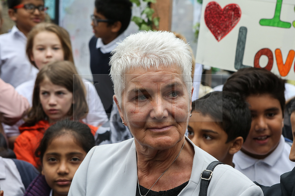© Licensed to London News Pictures. 16/06/2017. Birstall, UK. Jo Cox's mother Jean Leadbeater watches on as a choir of children sing in Birstall town square where the Labour MP was murdered a year ago today. Events are planned to take place across the country this weekend in memory of Jo Cox in what is being called 'The Great Get Together'. Credit: Ian Hinchliffe Photo credit : Ian Hinchliffe/LNP