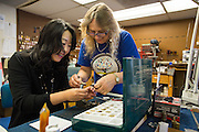 Mi;pitas Unified School District Assistant Superintendent Wendy Zhang shadows Locksmith Cindy Winborn during Classified School Employee Week at MUSD MOT in Milpitas, California, on May 19, 2016. (Stan Olszewski/SOSKIphoto)