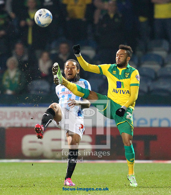 Sean Scannell of Huddersfield Town and Nathan Redmond of Norwich in action during the Sky Bet Championship match at the John Smiths Stadium, Huddersfield<br /> Picture by Paul Chesterton/Focus Images Ltd +44 7904 640267<br /> 17/03/2015