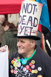 "London, April 16th 2016. A pensioner says ""I'm not dead yet"" as thousands of people supported by trade unions and other rights organisations demonstrate against the policies of the Tory government, including austerity and perceived favouring of ""the rich"" over ""the poor""."