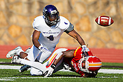 De'Vante Bausby (14) of the Pittsburg State Gorillas breaks up a pass intended for Taylor Gabriel (4) of the Abilene Christian Wildcats during Saturday's college football game at Carnie Smith Stadium on October 5, 2013 in Pittsburg, Kansas. (David Welker)