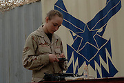 Senior Airman Charity L. Trueblood, combat convoy vehicle operator deployed to the 732 Expeditionary Logistics Readiness Squadron, at Balad Air Base, Iraq.  Trueblood is assigned to the 341st Logistics Readiness Squadron, Malmstrom Air Force Base, MT. Airman Trueblood's personal interest in vehicle mechanics and weapons are a match with her duties as a driver and 50-caliber machine gunner on HUMVEEs to M-1083 Medium Tactical Vehicles.The Herrick, IL native prowdly keeps her Cowden-Herrick High School ring on all her missions in the high threat zones of Iraq. (U.S. Air Force photo by Master Sgt. Lance Cheung)<br />
