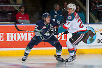 KELOWNA, CANADA - FEBRUARY 13: Calvin Thurkauf #27 of the Kelowna Rockets checks Mathew Barzal #13 of the Seattle Thunderbirds on February 13, 2017 at Prospera Place in Kelowna, British Columbia, Canada.  (Photo by Marissa Baecker/Shoot the Breeze)  *** Local Caption ***