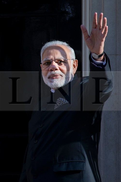 © Licensed to London News Pictures. 18/04/2018. London, UK. Indian Prime Minister Narendra Modi waves as he meets Prime Minister Theresa May at 10 Downing Street. Photo credit: Rob Pinney/LNP