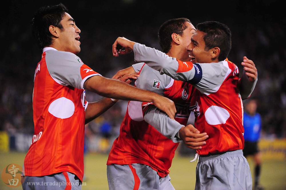 August 8, 2009; San Francisco, CA, USA; Chivas de Guadalajara midfielder Ramon Morales (right) is congratulated after scoring a goal during the second half against FC Barcelona in the Night of Champions international friendly contest at Candlestick Park. The game ended in a 1-1 tie.