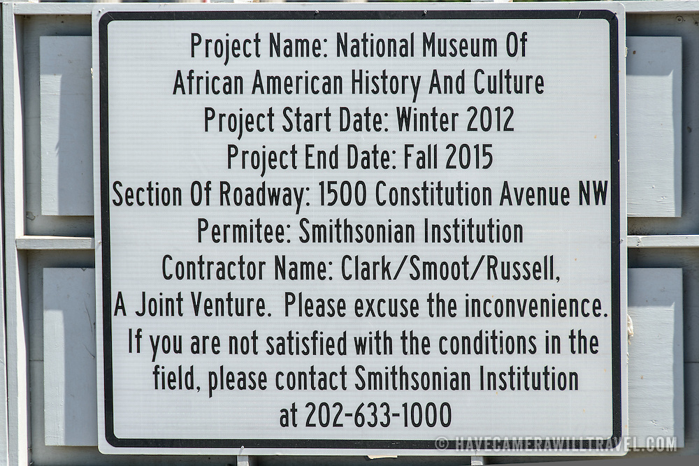 Smithsonian National Museum of African American History and Culture Construction Sign. The Smithsonian National Museum of African American History and Culture is being constructed on the National Mall at the corner of Constitution Avenue and 15th Street NW. Sign provides projected start and completion dates.