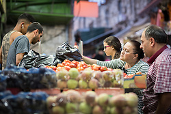 4 October 2018, Jerusalem: A woman buys fruit in the Jerusalem Old Town.