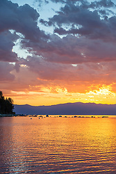 """Sunrise at Lake Tahoe 18"" - Photograph of a vibrant sunrise shot from a small fishing boat during the annual Jakes on the Lake charity fishing derby."