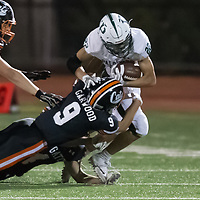 Los Gatos #9 Ryan Garwood brings down Palo Alto #22 Aiden Chang in a SCVAL Football Game at Los Gatos High School(Courtesy of Bill Gerth)