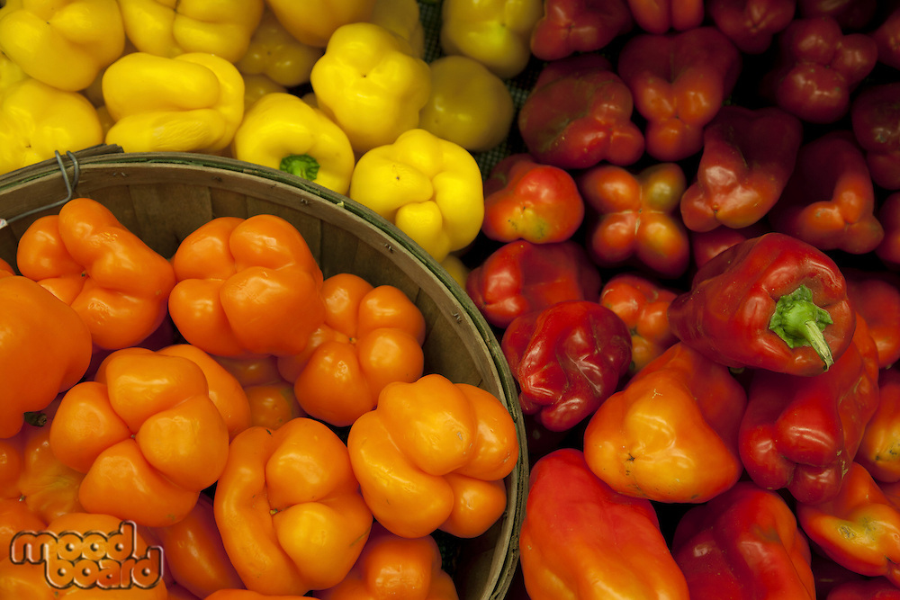 Multicolored bell peppers on display in market