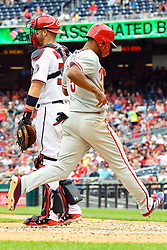 May 6, 2018 - Washington, DC, U.S. - WASHINGTON, DC - MAY 06:  Philadelphia Phillies right fielder Nick Williams (5) scores in the eighth inning as Washington Nationals catcher Matt Wieters (32) waits for the late throw during the game between the Philadelphia Phillies  and the Washington Nationals on May 6, 2018, at Nationals Park, in Washington D.C.  The Washington Nationals defeated the Philadelphia Phillies, 5-4.  (Photo by Mark Goldman/Icon Sportswire) (Credit Image: © Mark Goldman/Icon SMI via ZUMA Press)