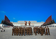 Soldiers paying respect to the Two Statues Of The Dear Leaders in the Grand Monument of Mansu Hill in Pyongyang, North Korea.