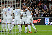 England striker Theo Walcott celebrates scoring the opening goal during the Group E UEFA European 2016 Qualifier match between England and Estonia at Wembley Stadium, London, England on 9 October 2015. Photo by Alan Franklin.