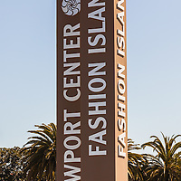 Photo of Fashion Island sign in Newport Beach California. Fashion Island is an upscale retail shopping mall in the wealthy town of Newport Beach in Orange County Southern California. Picture is high resolution and vertical.