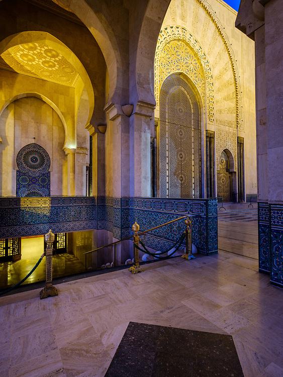 CASABLANCA, MOROCCO - CIRCA APRIL 2018: Exterior corridor and arches of the mosque  Hassan II in Casablanca at night.