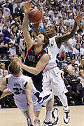 St. Mary's guard Matthew Dellavedova, center, is fouled by BYU center Nate Austin, bottom left, and forward Charles Abouo, right, during the second half of an NCAA college basketball game in Provo, Utah, Saturday, Jan. 28, 2012. (AP Photo/Colin E Braley)
