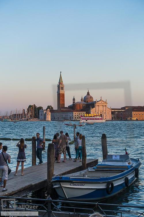 Cruise ship MSC Fantasia, Island of San Giorgio Maggiore in Venice at sun-set, Venice, Venetia, Italy