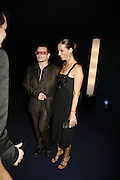 Bono and Ali Hewson Bono, Emporio Armani Red One Night Only. Brompton Hall, Earls Court. London. 21 September 2006.  . ONE TIME USE ONLY - DO NOT ARCHIVE  © Copyright Photograph by Dafydd Jones 66 Stockwell Park Rd. London SW9 0DA Tel 020 7733 0108 www.dafjones.com
