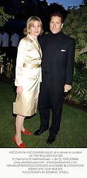 VISCOUNT & VISCOUNTESS LINLEY at a dinner in London on 19th May 2003.PJS 343