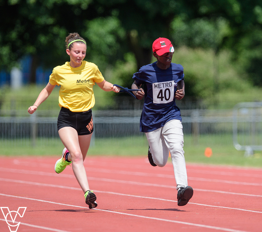 Metro Blind Sport's 2017 Athletics Open held at Mile End Stadium.  60m.  Ebenezer Adu-Poku with guide runner<br /> <br /> Picture: Chris Vaughan Photography for Metro Blind Sport<br /> Date: June 17, 2017