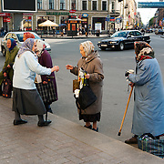 Women wait for a donation outside Vladimirskaya Church in Saint Petersburg, Санкт-Петербург, the second largest city in Russia, located on the Neva River near the Baltic Sea.<br /> Photography by Jose More