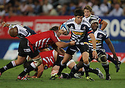 Jaque Fourie almost gets through the defense during the Super Rugby (Super 15) fixture between the DHL Stormers and the Lions held at DHL Newlands Stadium in Cape Town, South Africa on 26 February 2011. Photo by Jacques Rossouw/SPORTZPICS