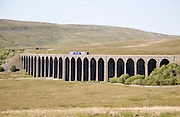 Northern Rail train crossing Ribblehead Viaduct, Yorkshire Dales national park, England, UK