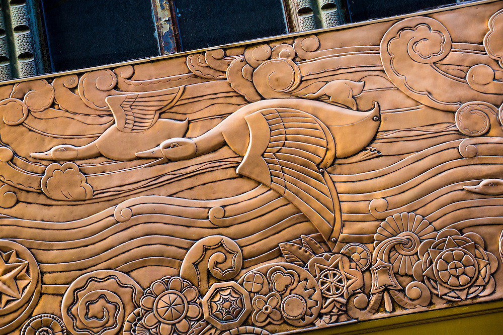 Bronze, Art Deco frieze on the Chanin Building depicts evolution