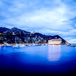 Catalina Island Avalon Bay at night picture with the Catalina Avalon Casino, Pacific Ocean and mountains. Catalina Island is a popular destination off the coast of Southern California in the United States.