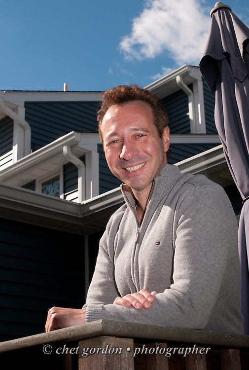 Craig Furer on the back deck of his Cranford, NJ home on Sunday, October 23, 2016. Furer and his wife Jen hired Magnolia Home Remodeling Group to complete a full exterior makeover. The company replaced the siding with shake and clapboard, added various architectural accents, replaced the roof, modified the roofline, built a front portico and replaced two windows. Craig spent a lot of time researching this project before it began and is thrilled with the overall result.  © Chet Gordon for Angie's List