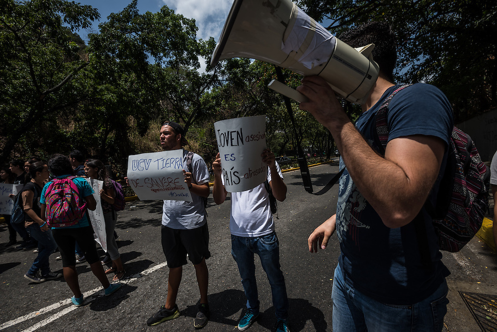 CARACAS, VENEZUELA - MAY 7, 2015:  Students protest against insecurity the day after a young man was murdered on the campus of The Central University of Venezuela. Venezuela has the second highest murder rate in the world, after Honduras, according to the Venezuelan Violence Observatory. Last year, there were 82 homicides for every 100,000 citizens last year, with a total of 24,980 homicides, it said.  PHOTO: Meridith Kohut for Buzzfeed News