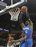 CHARLOTTE - APRIL 24:  Center Dwight Howard #12 of the Orlando Magic goes up for a slam dunk over guard Stephen Jackson #1 of the Charlotte Bobcats during Game Three of the Eastern Conference Quarterfinals during the 2010 NBA Playoffs at Time Warner Cable Arena on April 24, 2010 in Charlotte, North Carolina. NOTE TO USER: User expressly acknowledges and agrees that, by downloading and/or using this photograph, user is consenting to the terms and conditions of the Getty Images License Agreement.  The Magic beat the Bobcats 90-86.  (Photo by Mike Zarrilli/Getty Images) *** Local Caption *** Dwight Howard; Stephen Jackson