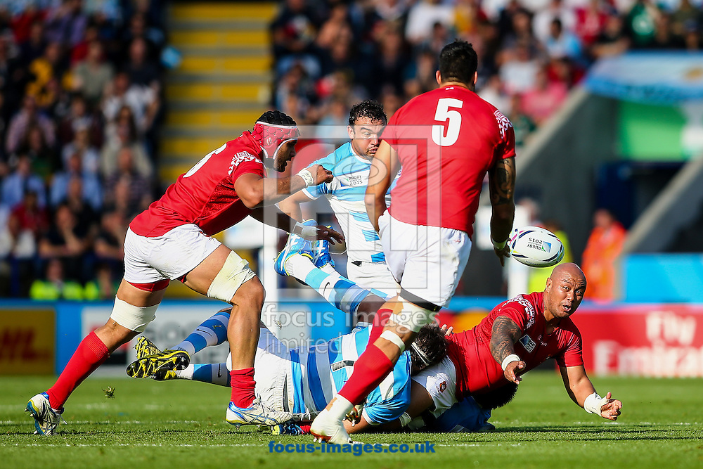 Nili Latu of Tonga (right) offloads in the tackle to Joseph Tuineau of Tonga (centre) during the 2015 Rugby World Cup match at the King Power Stadium, Leicester<br /> Picture by Andy Kearns/Focus Images Ltd 0781 864 4264<br /> 04/10/2015
