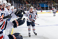 KELOWNA, BC - OCTOBER 12: Connor Zary #18 of the Kamloops Blazers celebrates a goal with fist bumps at the bench against the Kelowna Rockets at Prospera Place on October 12, 2019 in Kelowna, Canada. (Photo by Marissa Baecker/Shoot the Breeze)