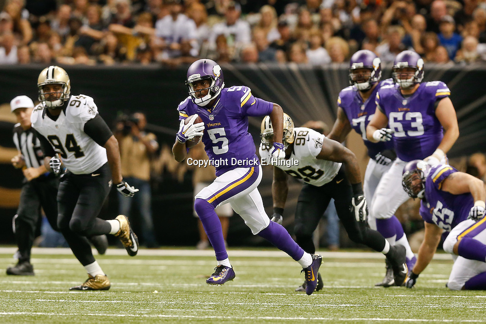 Sep 21, 2014; New Orleans, LA, USA; Minnesota Vikings quarterback Teddy Bridgewater (5) runs against the New Orleans Saints during the second quarter of a game at Mercedes-Benz Superdome. Mandatory Credit: Derick E. Hingle-USA TODAY Sports