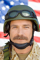 Soldier with moustache in front of United States flag (close-up) (portrait)